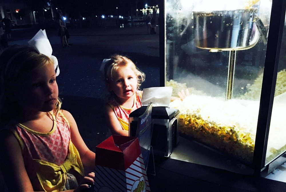 Movie goers enjoy popcorn at The Village of Baytowne Wharf's Sunday cinema.